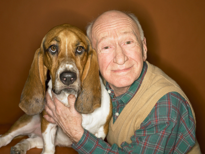 Studio Portrait of a Senior Man and His Basset Hound